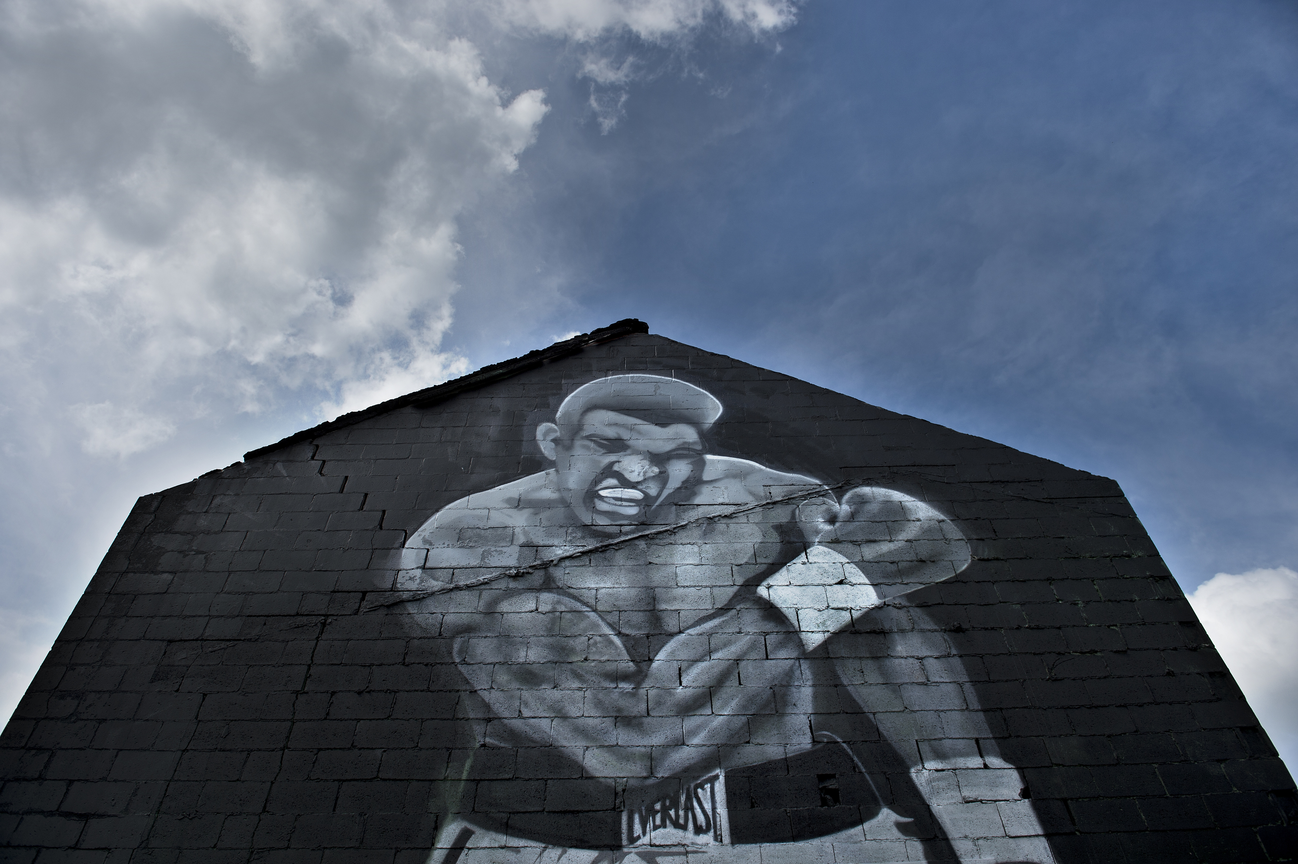 A mural with the image of boxing legend Muhammad Ali died June 3 at age 74 after a long battle with Parkinson's disease. / AFP PHOTO / Brendan Smialowski